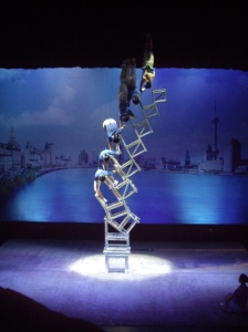 Acrobats balancing on chairs